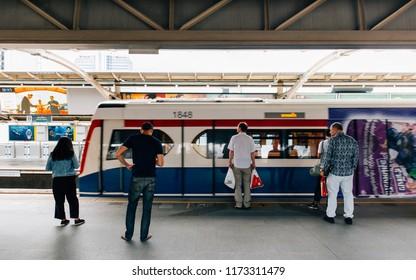 Bangkok, Thailand - September 01,2018: BTS Skytrain no.1848 arriving at platform. People stand behind the yellow line waiting BTS Skytrain.