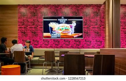 BANGKOK, THAILAND - SEPTEMBER 07: Flat panel display shows Mcdonald's TV commercial inside Mcdonald's fast food restaurant in Bangkok on September 07, 2018.