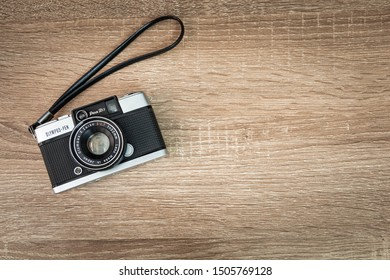 BANGKOK, THAILAND - September 1, 2019 : Olympus pen d3 vintage film camera  on wooden background.