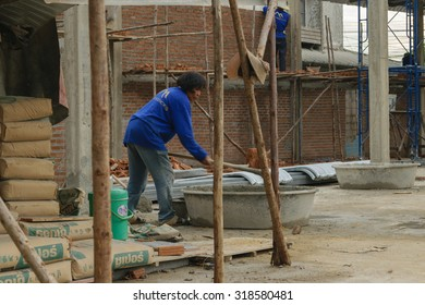 Bangkok, Thailand - September 11, 2015 : Unidentified construction worker mixing cement for building.