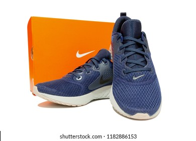 BANGKOK, THAILAND - SEPTEMBER 11, 2018: Nike Legend React men's running shoes and orange box, Blue Void color. Isolated on white background. Product shoot of Nike running shoes.