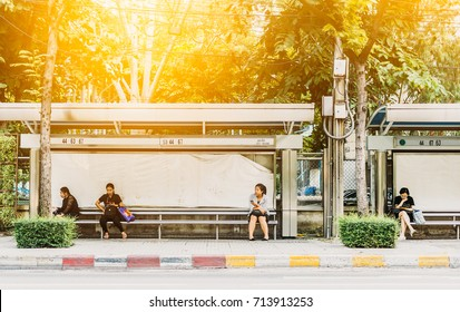 BANGKOK THAILAND -SEPTEMBER 12 2017: Unidentified People waiting public transport bus at bus stop station in Bangkok, Thailand
