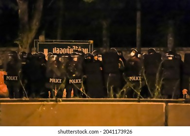 Bangkok, THAILAND - September 12, 2021: Riot police stand guard at Vibhavadi Rangsit Road near Royal Thai Army Band Department on the way to 1st Infantry Regiment, PM house.