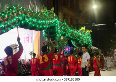 Bangkok, Thailand - September 14, 2015: Unidentified people and dragon dance celebrating Vegetarian  in China Town (Yaowarat), Bangkok, Thailand.