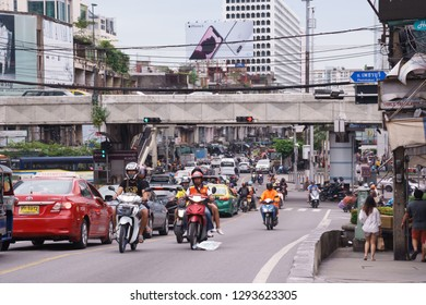 Bangkok, Thailand - September 14, 2018: Mototaxi with passenger driving on Ratchadamri Rd. during rush hour in the evening. Motorbike is the most fastest vehicles to travel in Bangkok