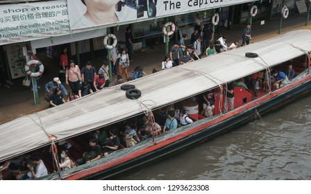 Bangkok, Thailand - September 14, 2018: Passengers get in a ferry boat at Pratunam Pier, The Saen Saep canal boat service carries about 60,000 passengers per day in city's traffic-congested