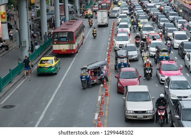 Bangkok, Thailand - September 14, 2018: Tuk Tuk taxi tries to escape from traffic jam by driving in the opposite direction on Ratchadamri Rd.