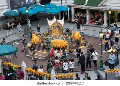 Bangkok, Thailand - September 14, 2018: Tourists pay respect the Erawan Shrine, Grand Hyatt Erawan Hotel