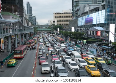 Bangkok, Thailand - September 14, 2018: Crowd of vehicles stand in a traffic jam after work in shopping district on Ratchadamri Rd.