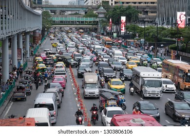 Bangkok, Thailand - September 14, 2018: Pickup truck from alley obstructs main road vehicles in a traffic jam after work on Ratchadamri Rd.