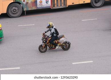 Bangkok, Thailand - September 15, 2018: Customized motorbike Honda MSX driving on Phayathai Rd. Modified vehicles prohibit on the road
