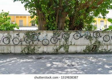 BANGKOK THAILAND SEPTEMBER 15 2019 , Bicycles wall hanging decoration at Tha Maharaj pier tourist attraction
