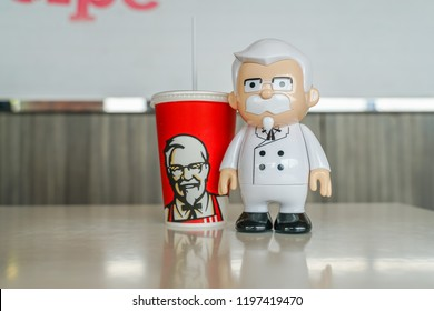 BANGKOK ,THAILAND- September 15,2018: Colonel Harland Sanders statue doll with KFC cold drink