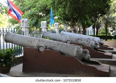 Bangkok, Thailand - September 16, 2016: Artillery found buried in the ground are displayed along the front side of the Grand Auditorium at Thammasat University.