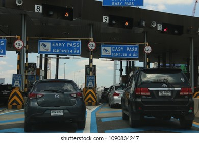 Bangkok, Thailand - September 16, 2016: Vehicles are in line to pay for expressway service by easy pass, the electronic toll collection system.
