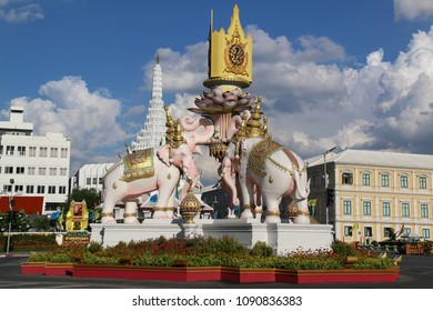 Bangkok, Thailand - September 16, 2016: The statues of White Elephants, the sign that the monarch reigns with justice and power, are holding the symbol of King Rama 9 over their heads.