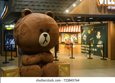 Bangkok, Thailand - September 16, 2017: Giant Size Brown (Bear) Doll in front of LINE Village Store at Siam Square One Shopping Center (the 1st Official LINE Store in Thailand).
