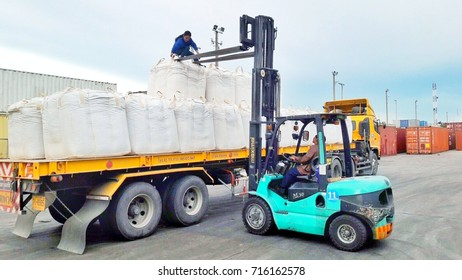 BANGKOK, THAILAND - September 16,2017 : Workers move jumbo bags from back of trailer by forklift at Ladkrabang Container yard, Thailand