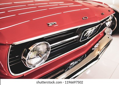 BANGKOK, THAILAND - SEPTEMBER 17, 2017: The American muscle car front view. Ford Mustang with reflection on bonnet after paint polishing & coating.