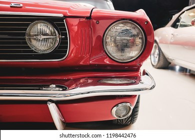 BANGKOK, THAILAND - SEPTEMBER 17, 2017: Close up of American muscle Ford Mustang. Front view with detail of headlight and fog lamp retro style. Illustration of classic car & vintage car restoration.