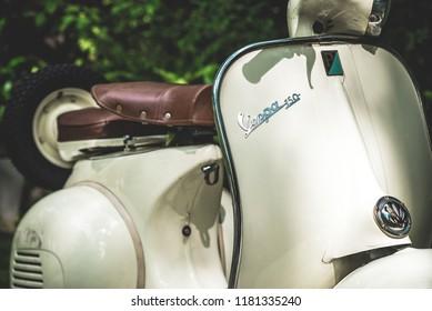 BANGKOK, THAILAND - September 17, 2018 : Vintage vespa parking in the park at Bangkok City, Thailand 2018