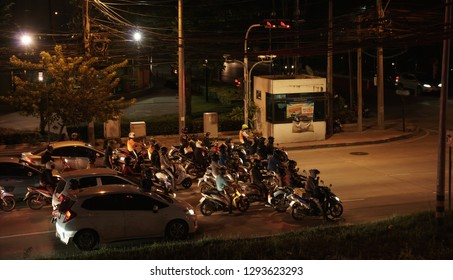 Bangkok, Thailand - September 17, 2018: Group of vehicles stand in red traffic light on Srinakarin Rd. at night