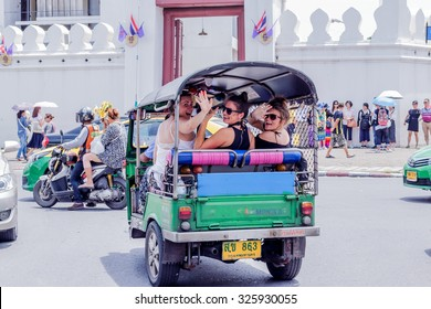 BANGKOK, THAILAND - SEPTEMBER 18, 2015 : Tourists are excited and enjoy in Tuk-Tuk, Samlors or three wheeled bikes that should not be missed in Bangkok trip.