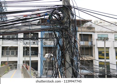 Bangkok, Thailand - September 18, 2016: Electricity and cable lines are installed disorderly on the pole.