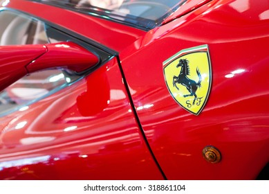 Bangkok, Thailand - September 19, 2015 : Logo of ferrari on the sport car at Central Embassy Shopping Mall. Ferrari S.P.A. is an Italian luxury sports car manufacturer. Founded by Enzo Ferrari