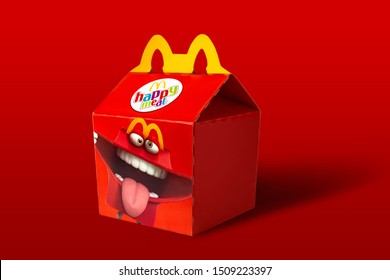 Bangkok ,Thailand - September 19 2019 : McDonald's Happy Meal box set Packaging on red background. McDonald's Corporation is the world's largest fast food restaurant.
