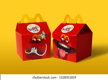 Bangkok ,Thailand - September 19 2019 : McDonald's Happy Meal box set Packaging on yellow background. McDonald's Corporation is the world's largest fast food restaurant. Illustrative editorial.
