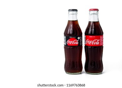 Bangkok, Thailand - September 2, 2018 : Two bottle of Coca-Cola with water drops isolated on white background.