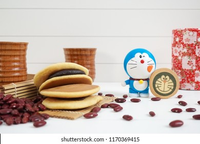 Bangkok, Thailand - September 2, 2018 : A photo of Doraemon, a Japanese all time super star robotic cat from the future, and his favorite confection, Dorayaki, a Japanese pancake with anko red beans.