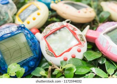 BANGKOK , THAILAND - september 2, 2018:virtual pet on grass. virtual pet toy 90s.