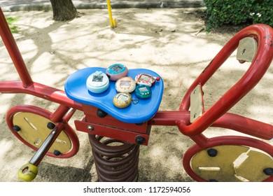 BANGKOK , THAILAND - september 2, 2018:virtual pet on spring bicycle. virtual pet toy 90s.
