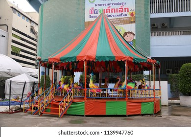 Bangkok, Thailand - September 20, 2016: Carousel is an amusement ride on a rotating platform with seats for riders.