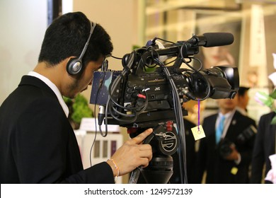Bangkok, Thailand - September 20, 2016: Cameraman is recording a performance on the stage.