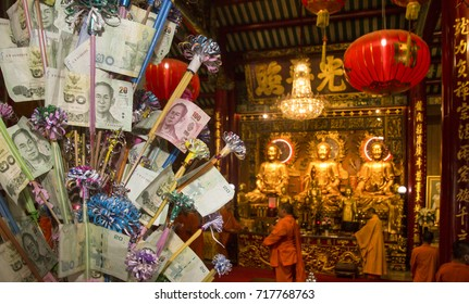 BANGKOK (THAILAND) - SEPTEMBER 2017: One of the altars inside Tai Hong Kong Shrine in Chinatown district. On the left side a money tree. Donating to a money tree is one way of making merit (thambun).