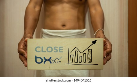 """Bangkok / Thailand - September 2019: A man stand and holding a blackboard have text """"Close bx.in.th"""" on it. Concept News about the closure of the website bx.in.th."""