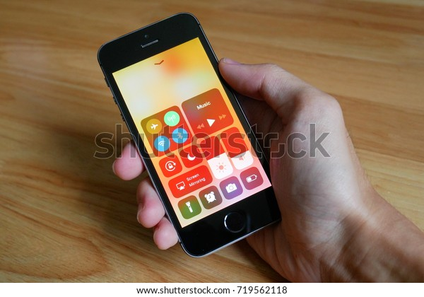 Bangkok, Thailand - September 21, 2017 : Apple iPhone5s held in one hand showing its screen with new Control Center in iOS 11.