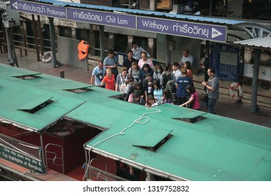 Bangkok, Thailand - September 21, 2018: Passengers get in a ferry boat at Chit lom Pier, The Saen Saep canal boat service carries about 60,000 passengers per day in city's traffic-congested
