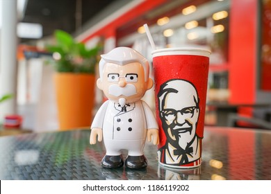 BANGKOK ,THAILAND- September 21,2018: Colonel Harland Sanders doll with cold drink in front of KFC restaurant