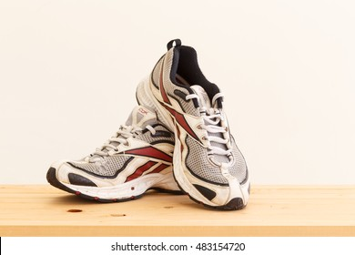 BANGKOK , THAILAND - September 2,2016: old style Reebok shoes. Taken at studio  Wooden background on September 2,2016 in Bangkok  Thailand