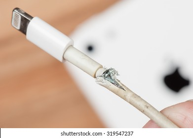 BANGKOK, THAILAND - SEPTEMBER 23, 2015: The broken iPhone charger cable.