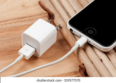 BANGKOK, THAILAND - SEPTEMBER 23, 2015: The iPhone5C connecting with the charger cable.