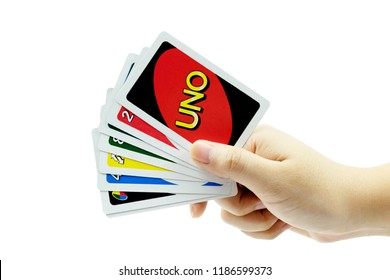 Bangkok, Thailand - September 23, 2018 : Uno card game on hand. clipping path.