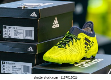 Bangkok, Thailand - September 23, 2018 : Football boots or soccer shoes in Adidas Brand and Stack of adidas black shoe boxes.