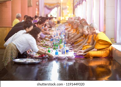 BANGKOK, THAILAND – SEPTEMBER 24: Many monks and novices sit in one row. And there are people who come together to make merit to offer food to monks on September 24, 2018 in Bangkok, Thailand.