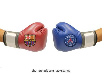 BANGKOK, THAILAND - SEPTEMBER 25, 2014: the logo of Barcelona and Paris Saint Germain football club on the boxing glove on the on 25 September 2014 in Bangkok Thailand.
