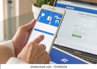BANGKOK, THAILAND - September 25, 2017: Facebook social media app logo on log-in, sign-up registration page on mobile application screen on iPhone smart devices in business person's hand